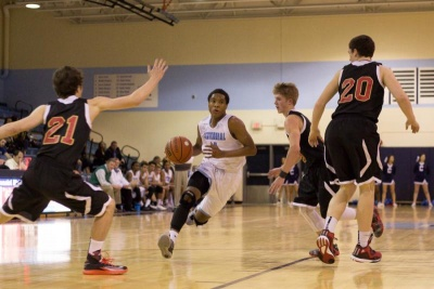 Basketball: Centennial fights off Ravenwood for district win