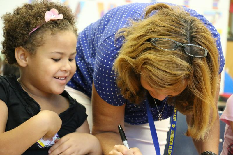Armed with crayons and glue, kindergarteners have first full day