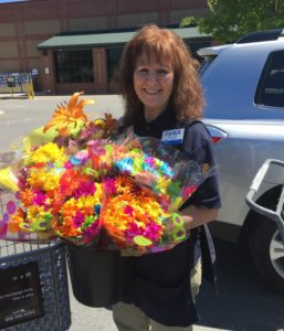 Senior care residents receiving beautiful bouquets from Petal Project